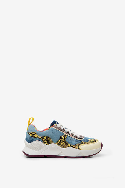 Patch jean and reptile skin sneakers