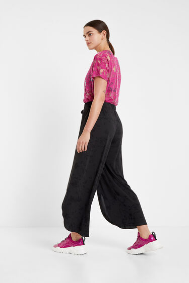 Flowing and floral palazzo trousers | Desigual