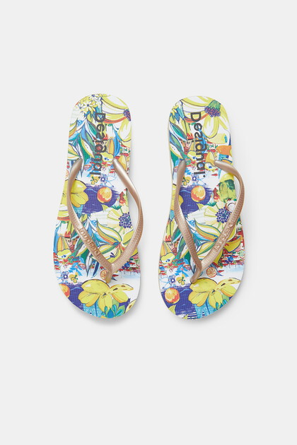 Golden bathing flip-flops printed sole