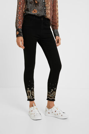 Skinny fit trousers embroidered ankles
