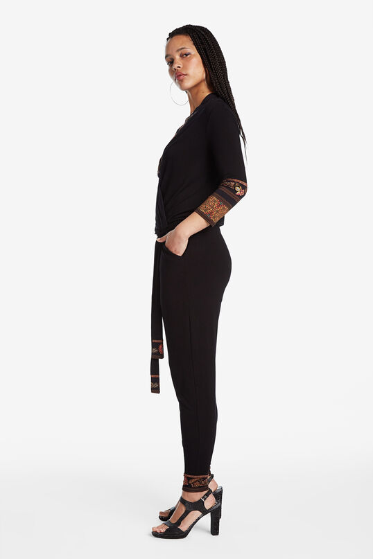 Black jumpsuit with ethnic frieze pattern details | Desigual