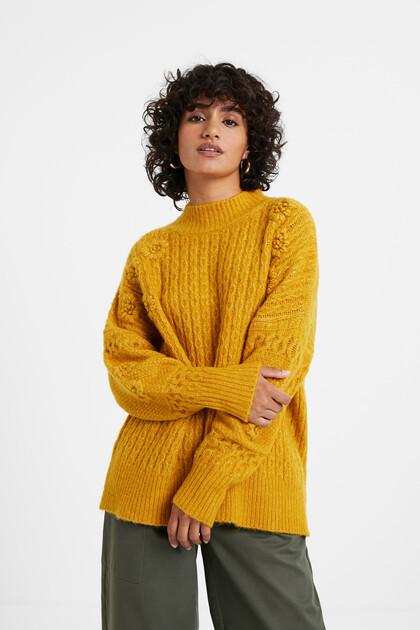 Trui van gevlochten tricot