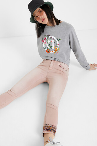 Jeans with ethnic friezes