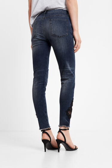 Semi-sheer guipure lace slim fit jeans | Desigual