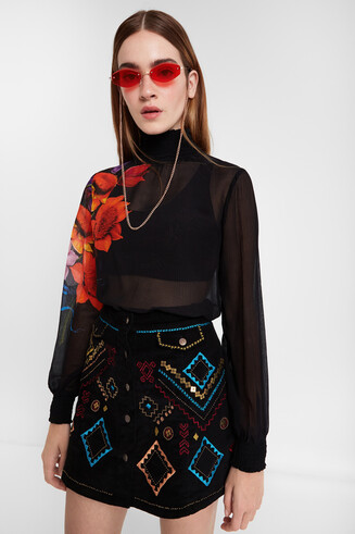 Black corduroy miniskirt with ethnic embroidery