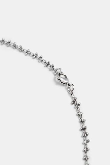Lange zilverkleurige ketting met bedels | Desigual
