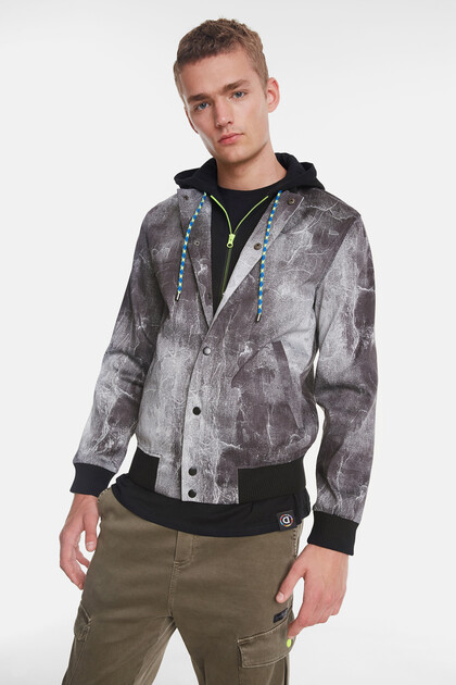 Sport jacket with detachable plush piece