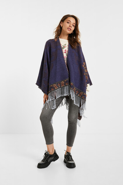 Reversible poncho tapestry