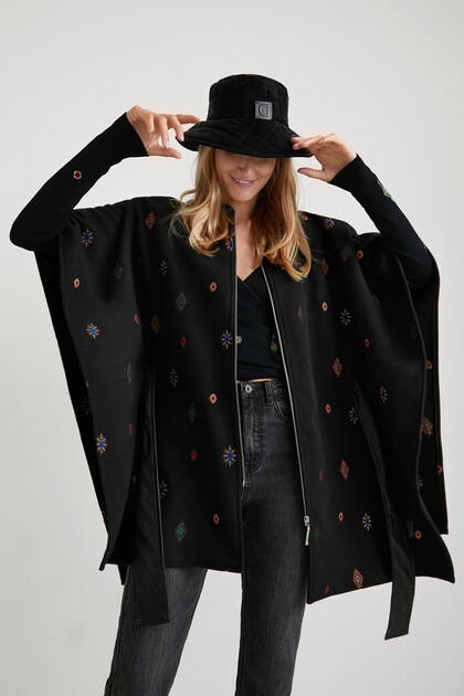 Poncho zipper embroideries