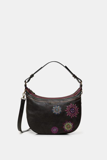 Vergrößerbare Tasche in Halbmondform