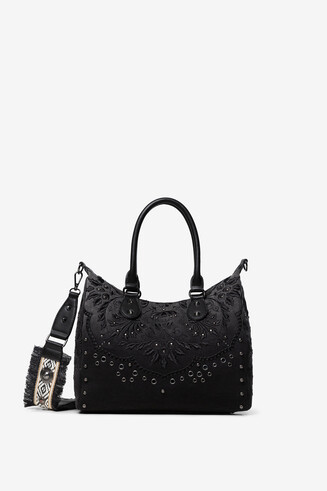 Bag embossed floral motifs and studs