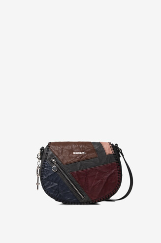 Sling bag with flap zipper