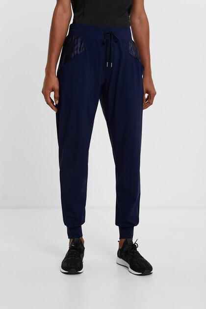 Spodnie o prostym kroju z troczkiem ściągającym