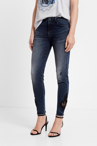 Semi-sheer guipure lace slim fit jeans