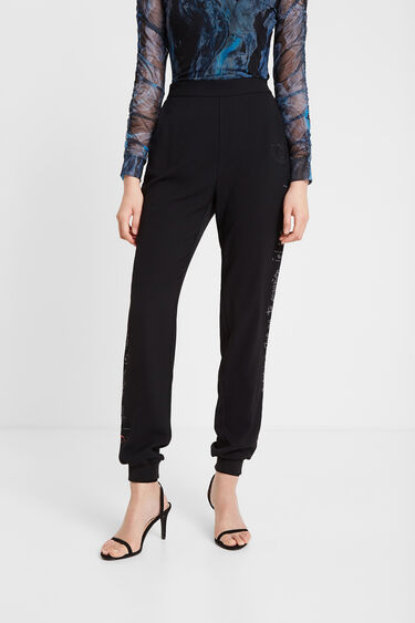 Pantalón chandal lentejuelas | Desigual