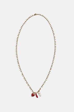 Long collier doré charms