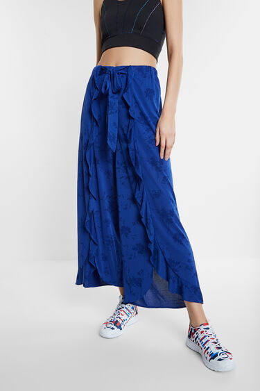 Palazzo floral trousers with flounces | Desigual