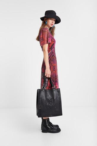 Wijd uitlopende jurk met twee lagen