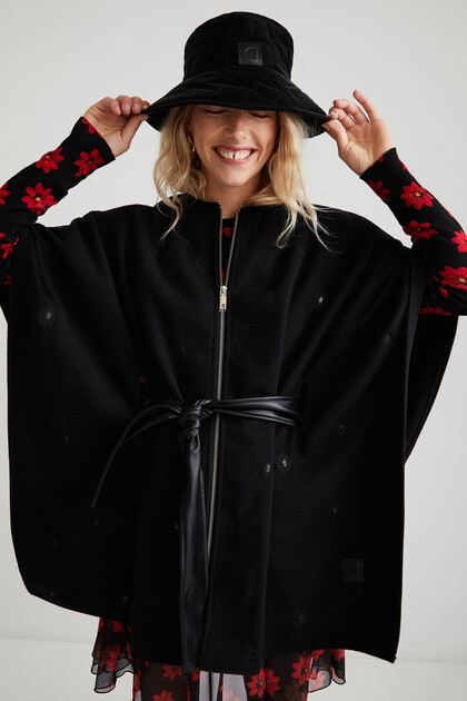 Poncho-cape belt and zipper