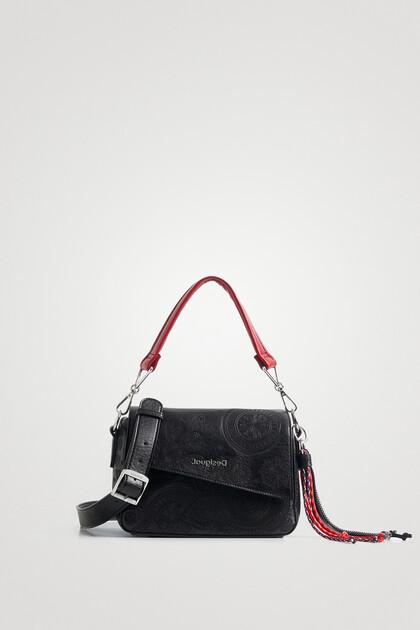 Handbag flap asymmetric